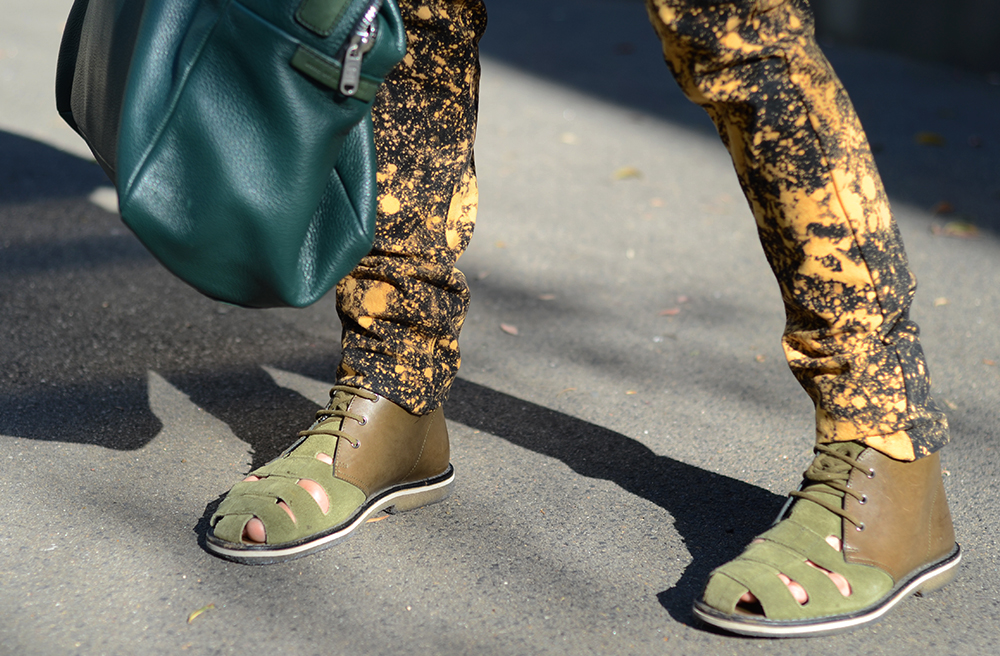 Raf Simons Sterling Ruby jeans, Marc Jacobs leather carryall bag, Neil Barrett green leather sandals